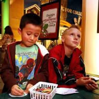 "Photo - Hayden Nelson, 6, left, and Weston Hutchins, 8, design ornaments during the ""Holiday Happening"" on Thursday at the Sam Noble Oklahoma Museum of Natural History. PHOTOS BY STEVE SISNEY, THE OKLAHOMAN"