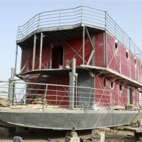 Photo - In this photo taken Nov. 24, 2012, an ark-like vessel which belongs to Lu Zhenghai sits while still under construction in China's northwest Xinjiang Uyghur Autonomous Region.  Lu Zhenghai is one of at least two men in China predicting a world-ending flood, come Dec. 21, the fateful day many believe the Maya set as the conclusion of their 5,125-year long-count calendar. Zhenghai has spent his life savings building the 70-foot-by-50-foot vessel powered by three diesel engines, according to state media. (AP Photo/ANPF-Chen Jiansheng)