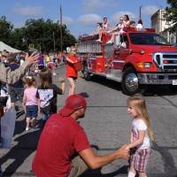Photo - In this Sept. 1, 2012 photo, a volunteer fire department truck turns the corner during the annual Westfest parade in West, Texas. Starting Friday, Aug. 30, 2013, the town will hold the signature celebration of its Czech heritage - the first Westfest since a deadly fertilizer plant explosion tore through the small Central Texas community in April 2013. (AP Photo/Waco Tribune Herald, Rod Aydelotte)