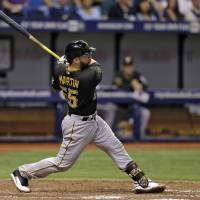 Photo - Pittsburgh Pirates' Russell Martin follows the flight of his home run off Tampa Bay Rays relief pitcher Brad Boxberger during the eighth inning of an interleague baseball game Tuesday, June 24, 2014, in St. Petersburg, Fla. (AP Photo/Chris O'Meara)