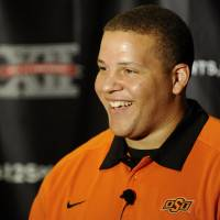Photo - Oklahoma State offensive lineman Lane Taylor smiles during the Big 12 Conference NCAA college football media days, Tuesday, July 24, 2012, in Dallas. (AP Photo/Matt Strasen) ORG XMIT: TXMS114
