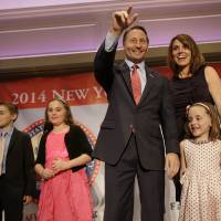 Photo - The Republican nominee for governor Rob Astorino, center, arrives on the stage with his wife, Sheila McCloskey, second from right, and their children Sean, left, Kiley, second from left, and Ashlin during the New York State Republican Convention in Rye Brook, N.Y., Thursday, May 15, 2014. Republicans wrapped up their state party convention Thursday in Westchester County after nominating Astorino and other candidates for statewide office.  (AP Photo/Seth Wenig)