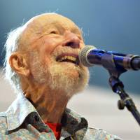 Photo - File-This Sept. 21, 2013, file photo shows Pete Seeger performing on stage during the Farm Aid 2013 concert at Saratoga Performing Arts Center in Saratoga Springs, N.Y.   The American troubadour, folk singer and activist Seeger  died Monday Jan. 27, 2014, at age 94.  (AP Photo/Hans Pennink, File)