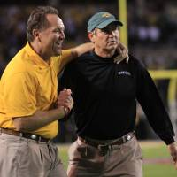 Photo - Baylor defensive coach Phil Bennett, left, and head coach Art Briles, right, celebrate in the final seconds of an NCAA college football game against Oklahoma, Saturday, Nov. 19, 2011, in Waco, Texas. Baylor won 45-38. (AP Photo/Tony Gutierrez) ORG XMIT: TXTG217