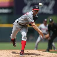 Photo - Washington Nationals starting pitcher Stephen Strasburg works against the Colorado Rockies in the first inning of a baseball game in Denver on Wednesday, July 23, 2014. (AP Photo)