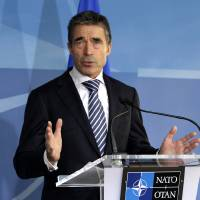 Photo -   NATO Secretary General Anders Fogh Rasmussen speaks during a media conference prior to a meeting of NATO Defense Ministers at NATO headquarters in Brussels on Tuesday, Oct. 9, 2012. NATO defense leaders gathering for a two-day meeting in Brussels, are committed to the war in Afghanistan, according to U.S. and alliance officials, but there are growing signs that the Afghan political and military hostilities against the coalition are starting to wear on the coalition. (AP Photo/Virginia Mayo)