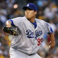Photo - Los Angeles Dodgers starting pitcher Hyun-Jin Ryu (99) delivers during the fourth inning of a baseball game against the Pittsburgh Pirates in Pittsburgh Monday, July 21, 2014. (AP Photo/Gene J. Puskar)