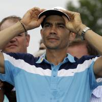 Photo - Camilo Villegas, of Colombia, reacts on the 18th green after winning the Wyndham Championship golf tournament in Greensboro, N.C., Sunday, Aug. 17, 2014. (AP Photo/Gerry Broome)