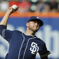 Photo - San Diego Padres' Jesse Hahn delivers a pitch during the first inning of a baseball game against the New York Mets, Saturday, June 14, 2014, in New York. (AP Photo/Jason DeCrow)