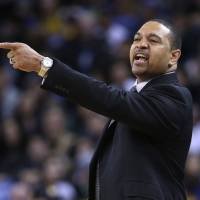 Photo - Golden State Warriors coach Mark Jackson directs his team against the Sacramento Kings during the first half of an NBA basketball game Friday, April 4, 2014, in Oakland, Calif. (AP Photo/Marcio Jose Sanchez)