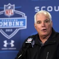 Photo - Atlanta Falcons head coach Mike Smith answers a question during a news conference at the NFL football scouting combine in Indianapolis, Friday, Feb. 22, 2013. (AP Photo/Michael Conroy)