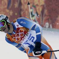 Photo - Norway's Aksel Lund Svindal finishes the slalom portion of the men's supercombined at the Sochi 2014 Winter Olympics, Friday, Feb. 14, 2014, in Krasnaya Polyana, Russia. (AP Photo/Gero Breloer)