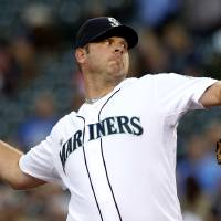 Photo -   Seattle Mariners starting pitcher Kevin Millwood throws to a Boston Red Sox batter in the second inning of a baseball game Wednesday, Sept. 5, 2012, in Seattle. (AP Photo/Elaine Thompson)