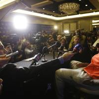 Photo - The Miami Heat's LeBron James speaks with reporters during the NBA All Star basketball news conference, Friday, Feb. 14, 2014, in New Orleans. (AP Photo/Gerald Herbert)