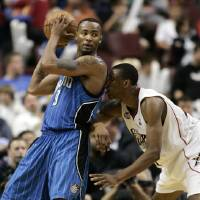 Photo - Orlando Magic forward Rashard Lewis, left, backs into Philadelphia 76ers forward Thaddeus Young, right, while moving toward the paint in the second half of a first-round NBA playoff basketball game Thursday, April 30, 2009, in Philadelphia. Lewis scored 29 points in the Magic's 114-89 win. (AP Photo/Tom Mihalek) ORG XMIT: PATM109