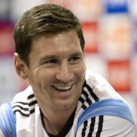 Photo - Argentina's Lionel Messi listens to a question at a news conference after a training session in Vespasiano, near Belo Horizonte, Brazil, Monday, June 16, 2014. Argentina plays in group F of the 2014 soccer World Cup. (AP Photo/Victor R. Caivano)