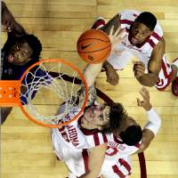 Photo - Ryan Spangler goes for a rebound as the University of Oklahoma Sooner (OU) men play the Kansas State Wildcats (KS) in NCAA, college basketball at The Lloyd Noble Center on Saturday, Feb. 22, 2014 in Norman, Okla. Photo by Steve Sisney, The Oklahoman