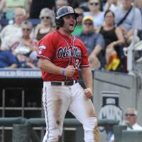 Photo - Mississippi's Sikes Orvis (24) reacts after scoring against Texas Tech on a single by Holt Perdzock in the seventh inning of an NCAA baseball College World Series elimination game in Omaha, Neb., Tuesday, June 17, 2014. (AP Photo/Eric Francis)