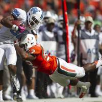 Photo -   Miami's Denzel Perryman (52) tries to knock North Carolina's Erik Highsmith (88) out of bounds during the first half of a NCAA college football game in Miami, Saturday, Oct. 13, 2012. (AP Photo/J Pat Carter)