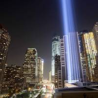 Photo - FILE- In this Sept. 10, 2013 file photo, the Tribute in Light rises into the night sky during a test in New York. The National September 11 Memorial and Museum will be closed to the public during the September 11 commemoration ceremony and much of the rest of the day, but it will be open from 6 p.m. to midnight for anyone who wants a close up view of the Tribute in Light. (AP Photo/Mark Lennihan, File)