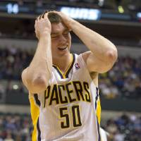 Photo - Indiana Pacers' Tyler Hansbrough reacts after being called for his second personal foul during the first half of an NBA basketball game against the Phoenix Suns, in Indianapolis, Friday, Dec. 28, 2012. (AP Photo/Doug McSchooler)