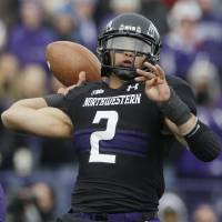 Photo -   Northwestern quarterback Kain Colter (2) throws a pass during the first half of an NCAA college football game against Illinois in Evanston, Ill., Saturday, Nov. 24, 2012. (AP Photo/Nam Y. Huh)
