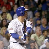 Photo - Chicago Cubs' Anthony Rizzo watches his home run off Cincinnati Reds starting pitcher Alfredo Simon during the sixth inning of a baseball game Monday, June 23, 2014, in Chicago. (AP Photo/Charles Rex Arbogast)