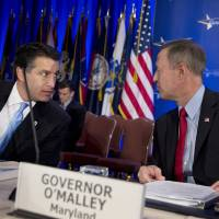 """Photo - Health and Homeland Security Committee Chairman Gov. Martin O'Malley of Maryland, right, and Vice Chairman Gov. Brian Sandoval of Nevada, talk at the start of the committee's meeting on """"Protecting Our Nation: States and Cybersecurity"""" during the National Governors Association 2013 Winter Meeting in Washington, Saturday, Feb. 23, 2013. Washington's protracted budget stalemate could seriously undermine the economy and stall gains made since the recession, exasperated governors said Saturday as they try to gauge the fallout from impending federal spending cuts. And both Democrat and Republican CEOs expressed pessimism that both sides could find a way to avoid the massive, automatic spending cuts set to begin March 1. (AP Photo/Manuel Balce Ceneta)"""