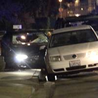 Photo - In this image provided by KEYT-TV, a car window is shot out after a mass shooting near the campus of the University of Santa Barbara in Isla Vista, Calif., Friday, May 23, 2014.  A drive-by shooter went on a