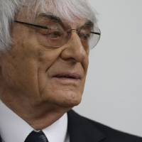 Photo - Formula One boss Bernie Ecclestone arrives for his trial in the regional court in Munich, southern Germany, Tuesday, Aug. 5, 2014. Ecclestone has been been on trial since April on charges of bribery and incitement to breach of trust. The charges involve a $44 million payment to banker Gerhard Gribkowsky, who's serving an 8 1/2-year sentence for taking the money. (AP Photo/Matthias Schrader)