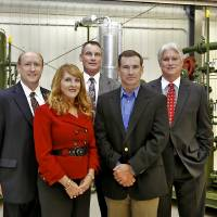 Photo - Compressco Partners LP's James Rounsavall, CFO, Sheri Vanhooser, VP of Business Development, Larry Brickman, VP of Field Services, Kenny Sylvester, VP of Production Operations and Ron Foster, President and CEO, pose for a photo in the manufacturing facility in Oklahoma City, Okla., Wednesday, Oct. 17, 2012. Photo by Chris Landsberger, The Oklahoman