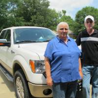 Photo -   Sharon and William Jones pose in front of the pickup truck they bought with some of their lottery winnings outside their home Wednesday, May 2, 2012 in Beebe, Ark. Sharon Jones, an Arkansas woman who cashed a $1 million lottery ticket may have to give up the winnings to Sharon Duncan. a woman who threw away the ticket after she bought it, according to a judge's ruling. (AP Photo/Jeannie Nuss)