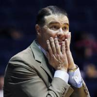 Photo - Kentucky coach Matthew Mitchell reacts to a play by his team against Mississippi in the first half of an NCAA college basketball game in Oxford, Miss., Thursday, Feb. 28, 2013. No. 10 Kentucky won 90-65. (AP Photo/Rogelio V. Solis)