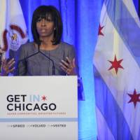 Photo - First lady Michelle Obama speaks about 15-year-old Hadiya Pendleton who was shot and killed on the south side of Chicago earlier this year during a luncheon at the Chicago Hilton in Chicago, Wednesday, April 10, 2013. The first lady is visiting Chicago for a discussion with Chicago Mayor Rahm Emanuel and civic leaders on ways to combat youth violence. (AP Photo/Paul Beaty)