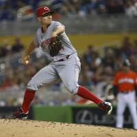 Photo - Cincinnati Reds starter Mike Leake pitches to the Miami Marlins during the second inning of a baseball game in Miami, Sunday, Aug. 3, 2014. (AP Photo/J Pat Carter)