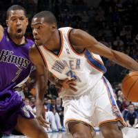 Photo - Oklahoma City's Kevin Durant drives around Sacramento's Dominic McGuire during the NBA basketball game between the Oklahoma City Thunder and the Sacramento Kings at the Ford Center in Oklahoma City, Tuesday, March 2, 2010.  Photo by Bryan Terry, The Oklahoman ORG XMIT: KOD