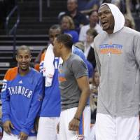 Photo -  Oklahoma City Thunder forward Kevin Durant, right, reacts to a basket in the fourth quarter of a preseason NBA basketball game against the Charlotte Bobcats in Oklahoma City, Tuesday, Oct. 16, 2012. The Thunder won 120-98. (AP Photo/Sue Ogrocki) ORG XMIT: OKSO112