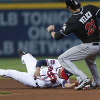 Photo - Atlanta Braves shortstop Andrelton Simmons (19) forces Miami Marlins' Christian Yelich (21) out at second base on a Jordany Valdespin (1) ground ball in the fourth inning of a baseball game  in Atlanta, Monday, July 21, 2014. (AP Photo/John Bazemore)