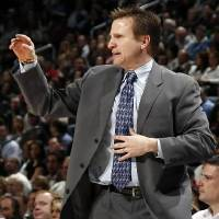 Photo - Oklahoma City head coach  Scott  Brooks gives instructions to his team in the first half during the NBA basketball game between the Dallas Mavericks and the Oklahoma City Thunder at the Ford Center in Oklahoma City, March 2, 2009. BY NATE BILLINGS