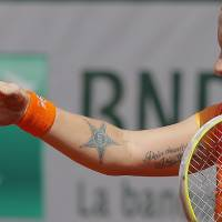 Photo - Russia's Svetlana Kuznetsova asks for her towel after falling on the clay as he plays Petra Kvitova, of the Czech Republic, during their third round match of  the French Open tennis tournament at the Roland Garros stadium, in Paris, France, Saturday, May 31, 2014. (AP Photo/Michel Spingler)