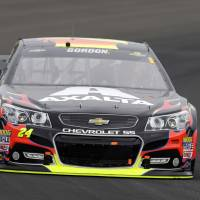 Photo - Jeff Gordon drives through Turn 1 during the Brickyard 400 auto race at Indianapolis Motor Speedway in Indianapolis, Sunday, July 27, 2014.  (AP Photo/Tom Strattman)