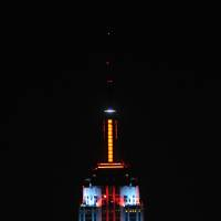 Photo -   In this Nov. 26, 2012, photo provided by the Empire State Building, the top floors of New York's Empire State Building are lit in gold, red, blue and white light after they being switched on by R&B star Alicia Keys. The landmark boasts a new LED lighting system with a palette of more than 16 million colors in limitless combinations, including ripples, sparkles, chasers, sweeps, strobes and bursts. The old lights came in only 10 colors. (AP Photo/Empire State Building, Bryan Smith)