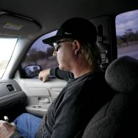 Photo - Lt. Darrell Southerland (left) of Lawton's Gang Task Force drives past Fort Sill in Lawton on Wednesday Nov. 5, 2008. By John Clanton, The Oklahoman ORG XMIT: KOD