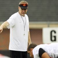 Photo - OKLAHOMA STATE UNIVERSITY / OSU COLLEGE FOOTBALL: New defensive coordinator Glenn Spencer (left) gives instructions to the defense during practice on August 2, 2013 in preparation for the fall season. Spencer is taking over defensive coordinator duties from departing coach Bill Young. Photo by KT KING, The Oklahoman