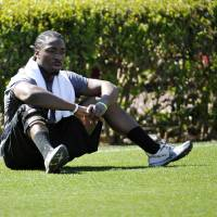 Photo - Running back Marcus Lattimore looks on during South Carolina's NFL football pro day on Wednesday, March 27, 2013 in Columbia, S.C. (AP Photo/Rainier Ehrhardt)