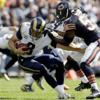Photo -   St. Louis Rams quarterback Sam Bradford (8) is sacked by Chicago Bears linebacker Nick Roach (53) in the second half of an NFL football game in Chicago, Sunday, Sept. 23, 2012. The Bears won 23-6. (AP Photo/Nam Y. Huh)