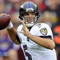 Photo - Baltimore Ravens quarterback Joe Flacco passes the ball during the first half of an NFL football game against the Washington Redskins in Landover, Md., Sunday, Dec. 9, 2012. (AP Photo/Nick Wass)