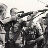 Photo - FORMER GOVERNOR / GOV. / HENRY BELLMON / DEATH / DIED TUESDAY, 09/28/2009:  On a trip to Vietnam, Gov. Henry Bellmon sights through a Russian sniper rifle captured by U.S. troops during an operation in 1965. OKLAHOMAN ARCHIVE PHOTO 			ORG XMIT: 0909292230380316
