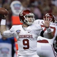 Photo - Oklahoma quarterback Trevor Knight (9) passes against Alabama during the first half of the Sugar Bowl NCAA college football game, Thursday, Jan. 2, 2014, in New Orleans. (AP Photo/Patrick Semansky)