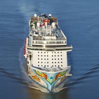 "Photo - This undated image provided by Norwegian Cruise Lines shows Norwegian Getaway, a ship debuting this month. It will homeport in Miami and its colorful exterior was designed by Miami-based Cuban-American artist David Le Batard, also known as ""LEBO."" Getaway is a sister ship to Norwegian Breakaway, which debuted in 2013 with a New York theme and homeports from Manhattan. (AP Photo/ Norwegian Cruise Lines)"